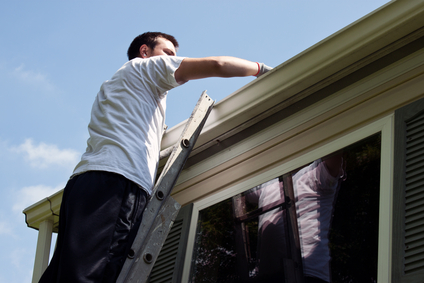 Exterior maintenance clearing gutters and replacement windows