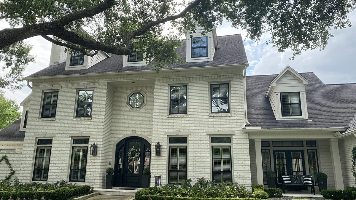Black Texas-Made Replacement Windows Installed in a Beautiful White Home